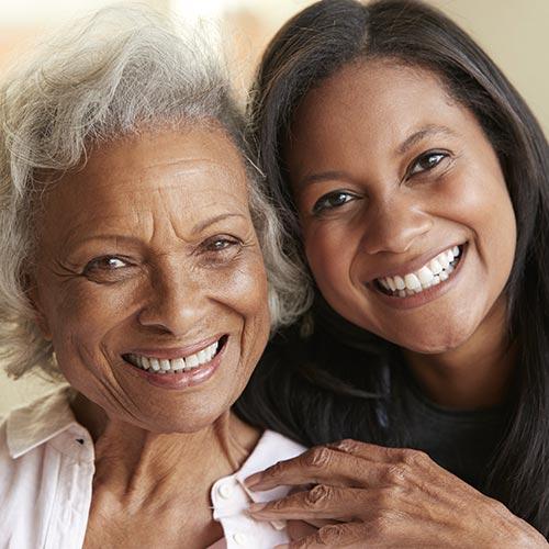 mother daughter hugging smiling